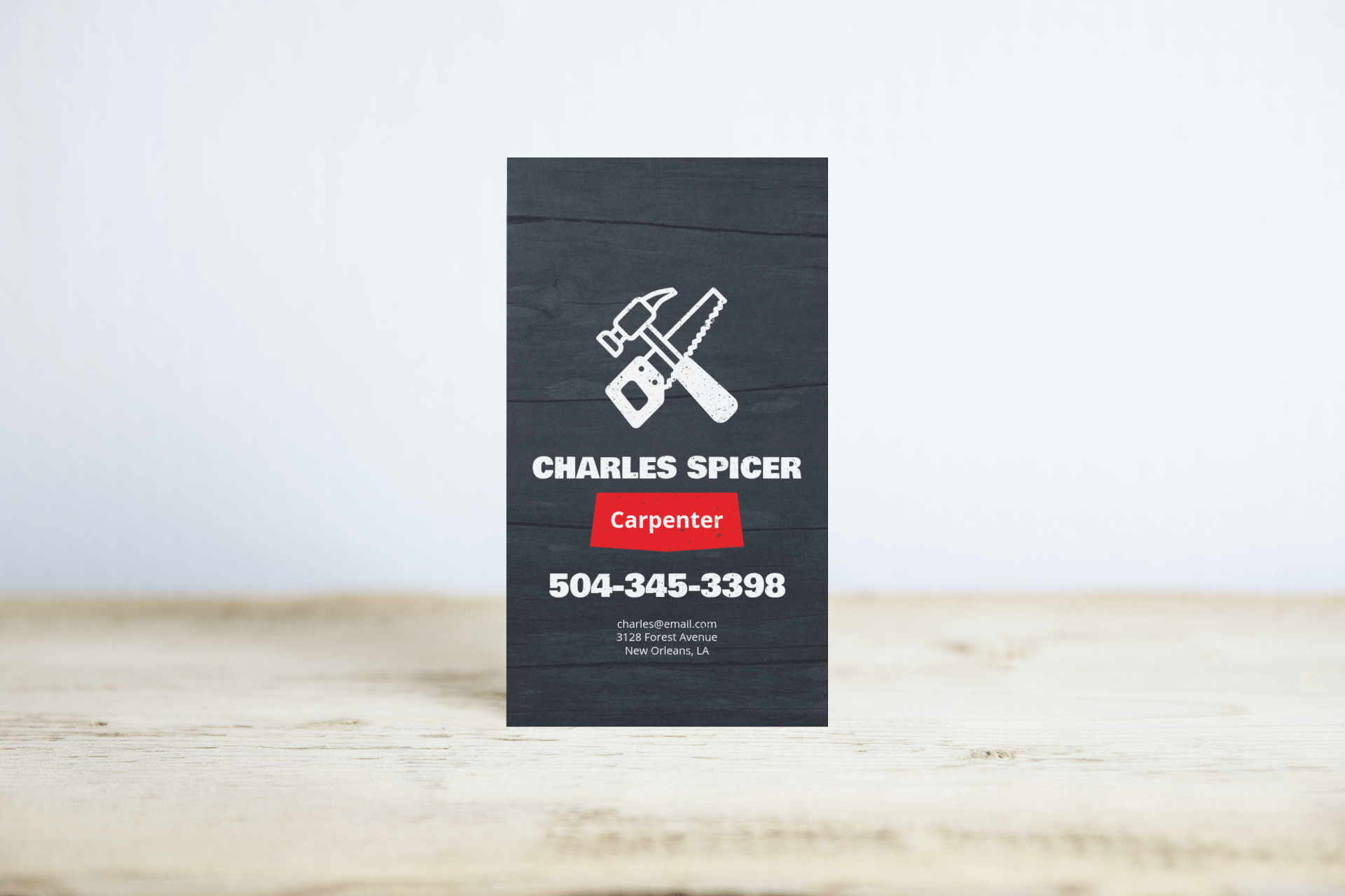 mockup of a vertical business card standing on a wooden surface 744 el